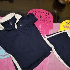 Girl Nike tennis skirt and polo shirt